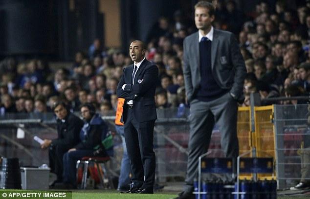 Job done: Chelsea boss Roberto Di Matteo (left) looks on inside the Parken Stadium