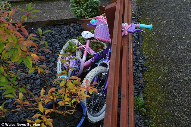Possession: Pictured is what is believed to be April's bicycle outside her house. She was said to have been playing with her bicycle when abducted