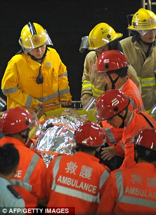 Rescuers carry one of the injured
