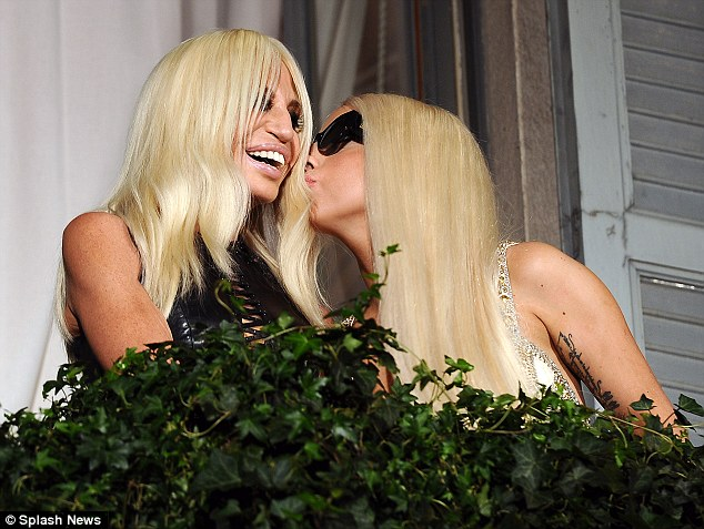 Cuddling up: The pair appeared to get on swimmingly, with Gaga even giving Donatella a kiss on the cheek