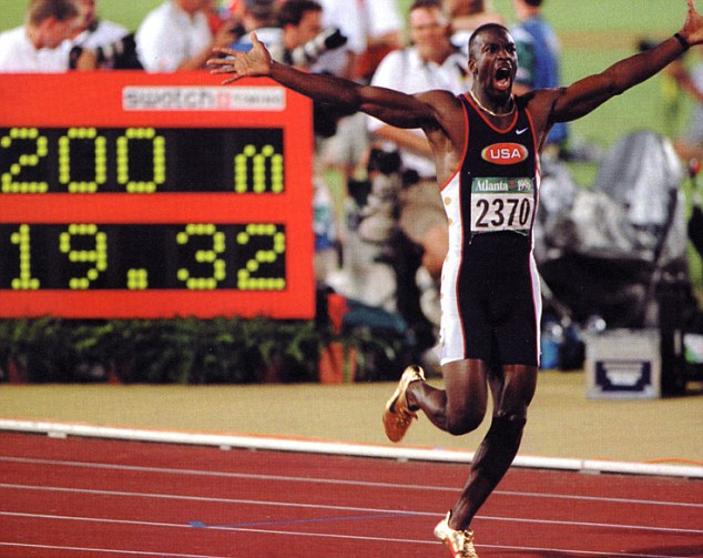 Going for gold: Michael Johnson won four Olympic titles in 200m and 400m