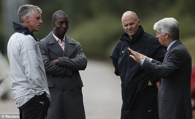 Going for gold: Olympic legend Michael Johnson popped into Arsenal training at London Colney