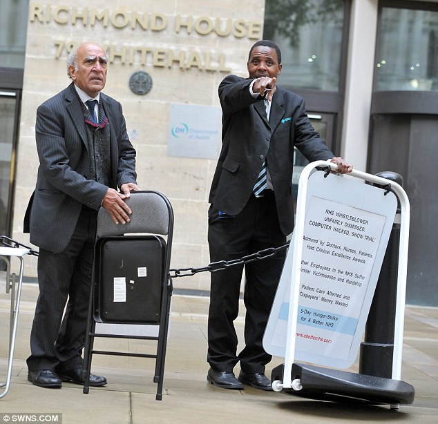 Protest: Dr Narinder Kapur is confronted by security staff outside the Department of Health in London.