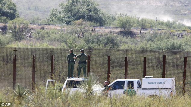 Shot at: The agents were fired upon in a rugged hilly area about five miles north of the border as they responded to an alarm that was triggered on one of the sensors installed to alert possible breaches