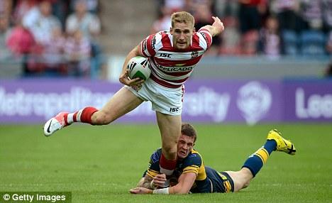 Last ditch: Hardaker challenges Sam Tomkins of Wigan
