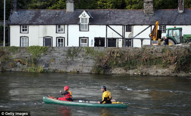 Canoeists search river banks in the hope of finding the girl before it got dark last night