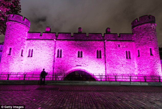 Bright and bold: UK landmarks including the Tower of London have also been lit up pink for Breast Cancer Awareness Month