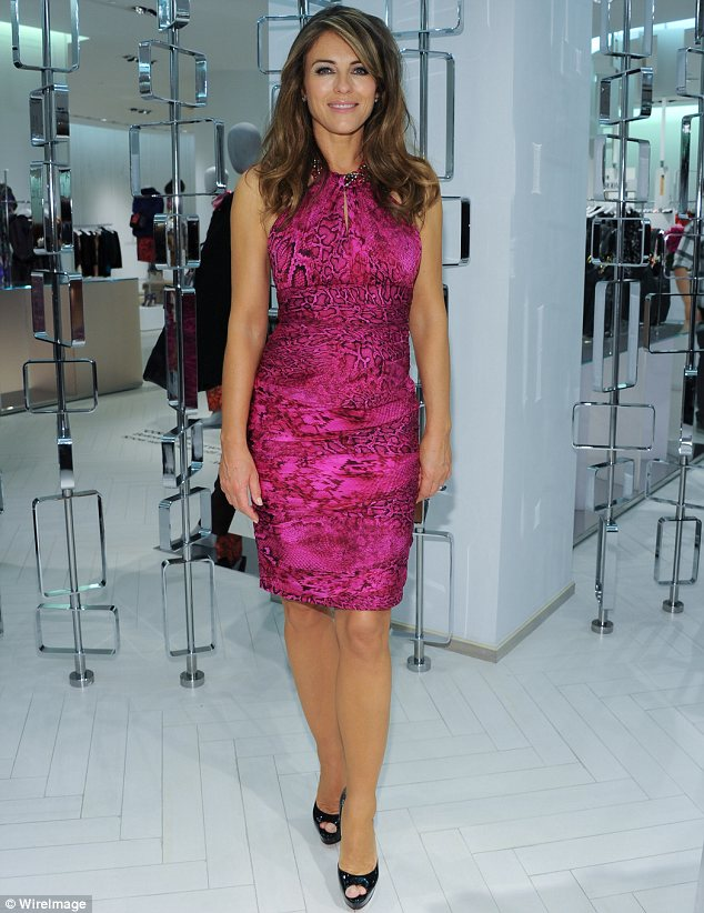 Good cause: On Tuesday she wore a fuchsia snakeskin dress to a celebration of the Estee Lauder Companies' Breast Cancer Awareness Campaign