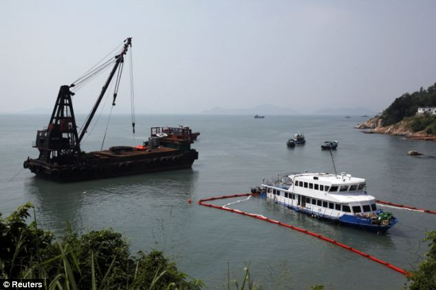 Investigation: The company boat is seen as it is inspected by government personnel