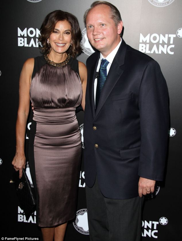 Friends in high places: The actress stands with her arm wrapped around President and CEO of Montblanc North America Jan-Patrick Schmitz at venue