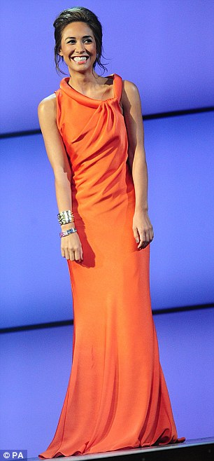 Red carpet moment: Myleene wore an orange cowl-neck column dress on-stage and arrived in a black and silver ball gown