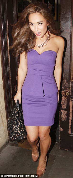 Purple haze: Myleene Klass leaves the Classical Brit Awards at the Royal Albert all in a strapless dress from her own range
