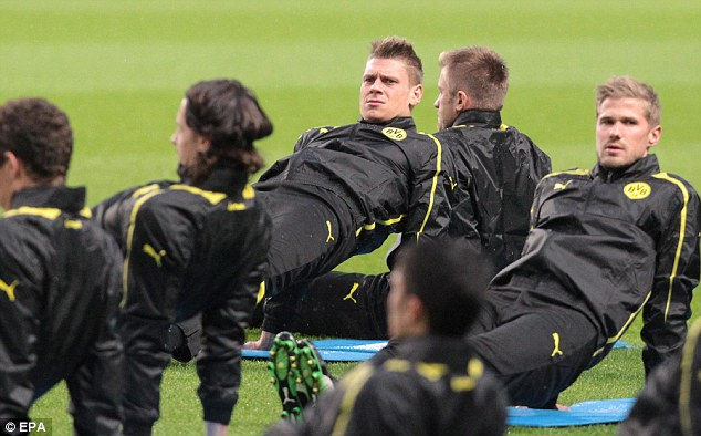 Tough test: Borussia Dortmund's squad in training ahead of their Champions League date in Manchester