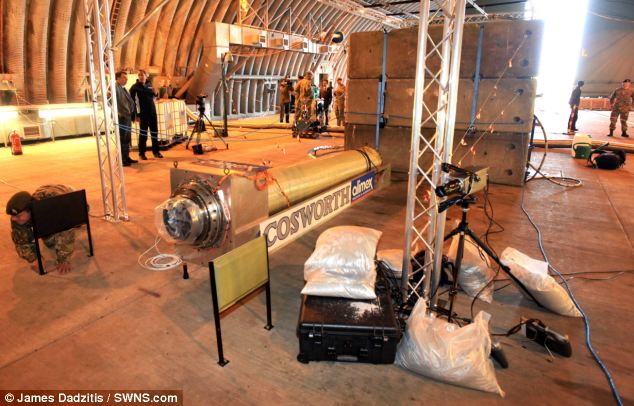 Scientists in Cornwall planning to test fire the first new rocket built in Britain for 20 years. The rocket is seen here with the 'Cosworth' sign on the side, and will power the Bloodhound car to an estimated 1050mph