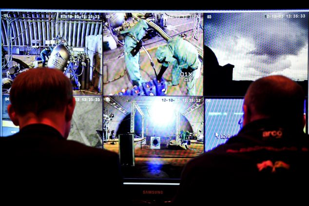 Engineers check monitors showing the Cosworth engine and rocket from Bloodhound SSC inside a hardened shelter at RAF St Mawgan, Newquay, where the engine is on test