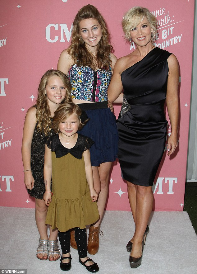Busy mother: Jennie poses with her three daughters Luca Bella, Lola Ray and Fiona Eve back in April this year