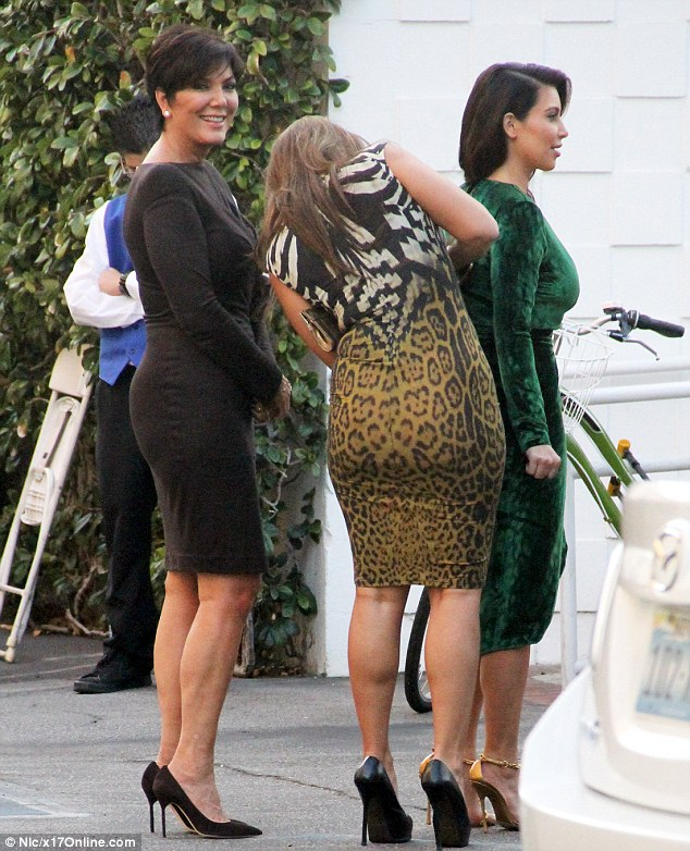 To the rescue: Kim's mother Kris Jenner and assistant raced to the rescue to fix the wardrobe malfunction