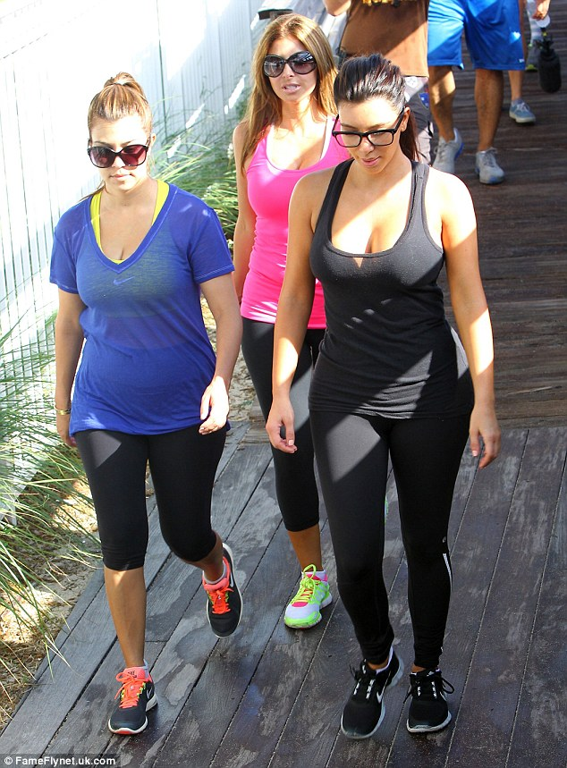 Ready to sweat: The trio were seen strolling on the boardwalk making their way to the beach