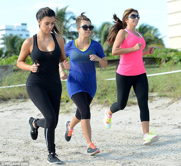 Morning jog: On Wednesday during her work-out, the reality star was also joined by her sister Kourtney and their Real Housewives Of Miami pal, Larsa Pippen