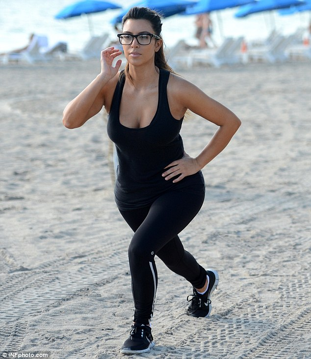 Sexy workout gear: The 31-year-old displayed plenty of cleavage in a black sheer tank top, which she paired with tight leggings, that in turn highlighted her famous derriere