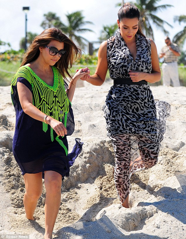 Helping hand: Kourtney helped her little sister down the sand dunes