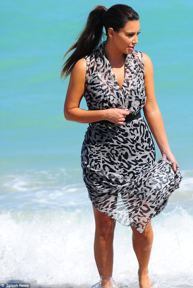 Taking a walk on the wild side: Kim slipped into an animal print dress for the occasion