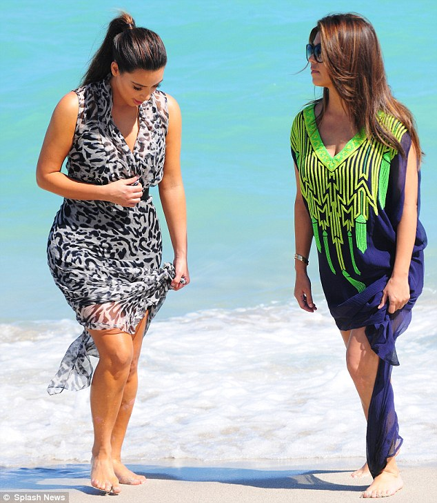 Fun in the sun: Later in the day, Kim and Kourtney were seen leaving the back of their hotel to take a walk on the beach