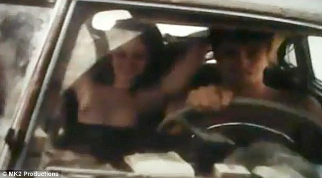Topless: Kristen is also seen in a topless scene while sitting in a car next to co-star Garrett Hedlund and English actor Sam Riley