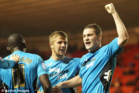 Leaving it late: Paul Coutts celebrates with team mates after scoring Derby's equalizer