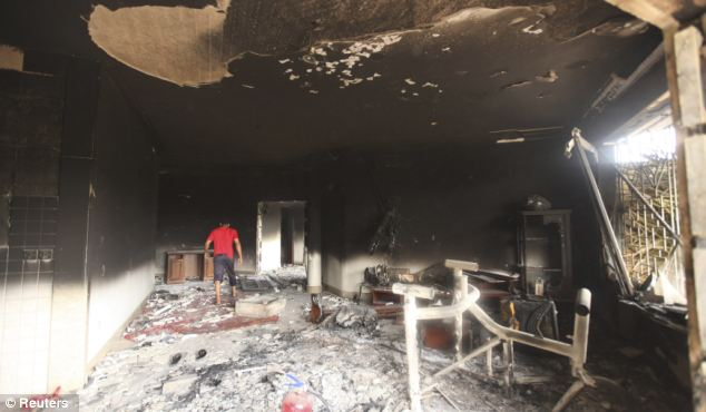Remains of the consulate: Two Tunisian nationals have been arrested in Instanbul in connection with the attack on the US consulate in Benghazi (pictured)