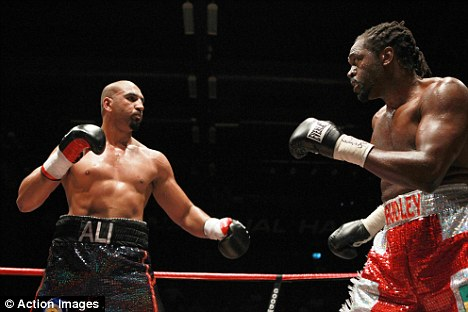 Defeat: Adams was stopped in the fourth round by Sydney 200 Olympics champion Harrison in Essex