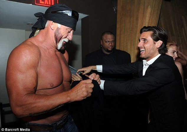 The odd couple: The muscular wrestling champion and the dapper reality TV squire make friends