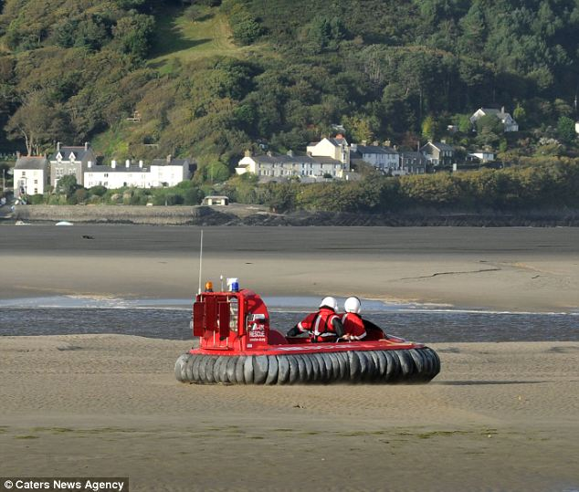 Difficult conditions: A hovercraft search and rescue team broke down 100metres from its start point after its skirt was ripped apart on the River Dovey estuary