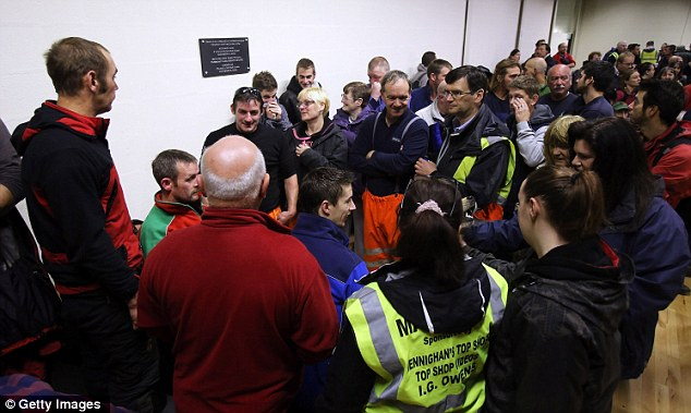 Volunteers gather at the Bro Ddyfi Leisure Centre before resuming their search for missing April Jones