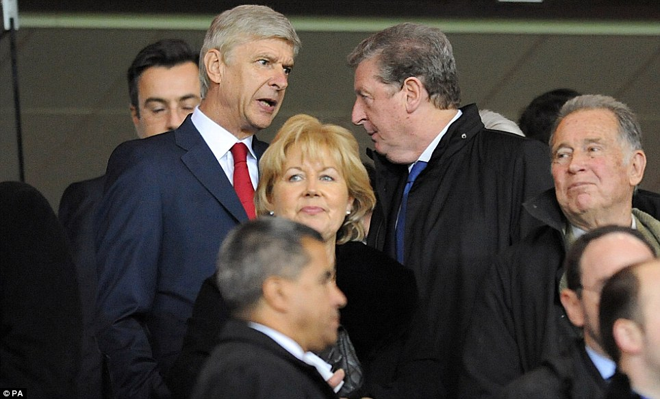Time for a chat: Wenger and Hodgson exchange information at the Emirates