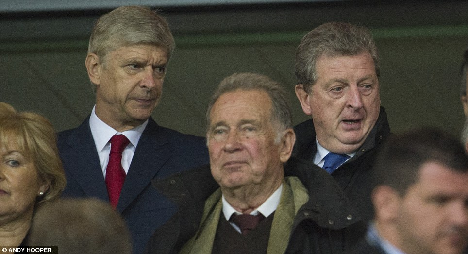 Bit safer here: Hodgon sat with Arsenal boss Arsene Wenger in the stands for the Olympiacos match