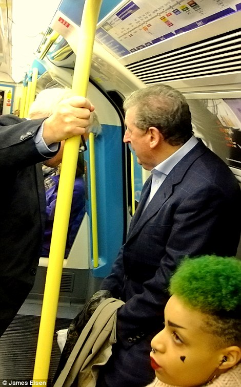 Up for a chat: Hodgson speaks to fans on the tube