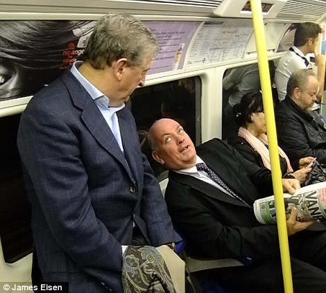 Be coy, Roy: The England manager speaks to his fellow passengers on the Jubilee Line