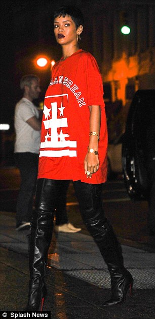 Dressed to impress: Rihanna wore a red T-shirt over what appeared to be thigh-high boots