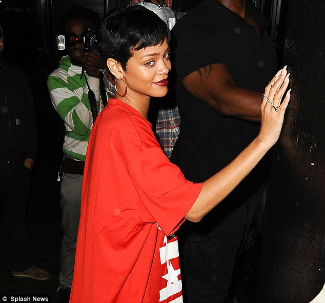 So good to see you! Rihanna waved at fans as she headed to a recording studio from her hotel