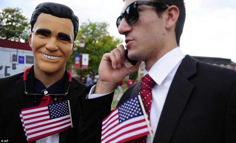 The sincerest form of flattery: Two teenage Romney supporters gather before the debate
