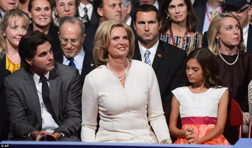 First Lady? Ann Romney sits in the front row at the debate with her son Tagg