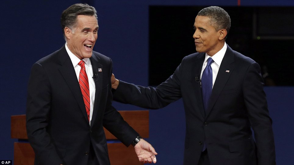A picture tells a thousand words: Mr Romney appeared delighted with his performance at the end of the evening