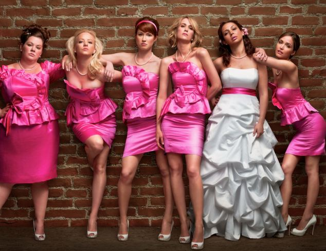 Testing times: In the film Bridesmaids, Kristen Wiig, third right, plays a woman forced to jump through endless hoops for her friend's wedding
