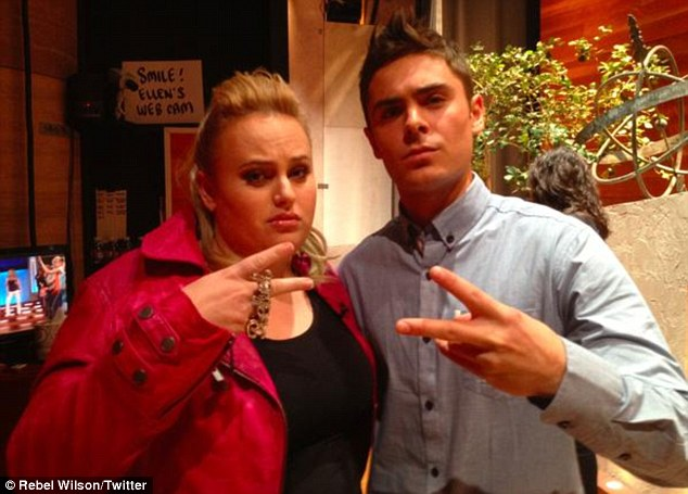 Aaaight! Rebel poses backstage with Zac Efron
