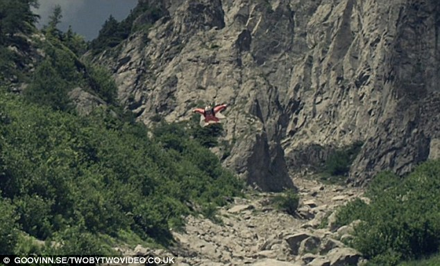 Flight of fancy: Fearless Espen skims through a rocky valley just a few metres from the ground in a shot from the breathtaking new video