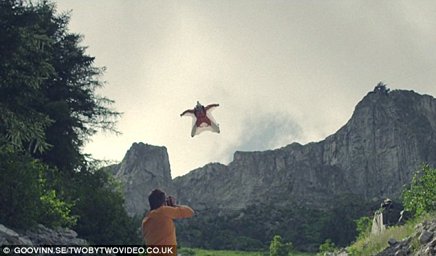 Shooting the breeze: The fearless Norwegian soars above a photographer during his sensational flight