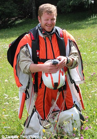 Back on terra firma: Espen, from Trondheim, Norway, with his specially designed wingsuit and helmet camera