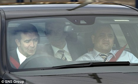 Verdict: Green (centre) with non-executive director Imran Ahmad (right) and head of football administration Andrew Dickson outside Hampden Park on Thursday