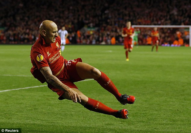 Two footed celebration: Shelvey celebrates his goal with a two footed lunge